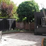 Cortenstaal en robuuste schutting in de tuin